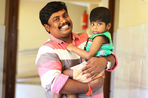 top-image-iyyappan-holding-child